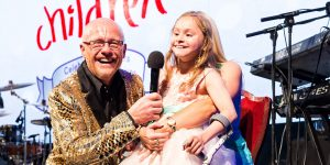 john caudwell with disabled girl on stage