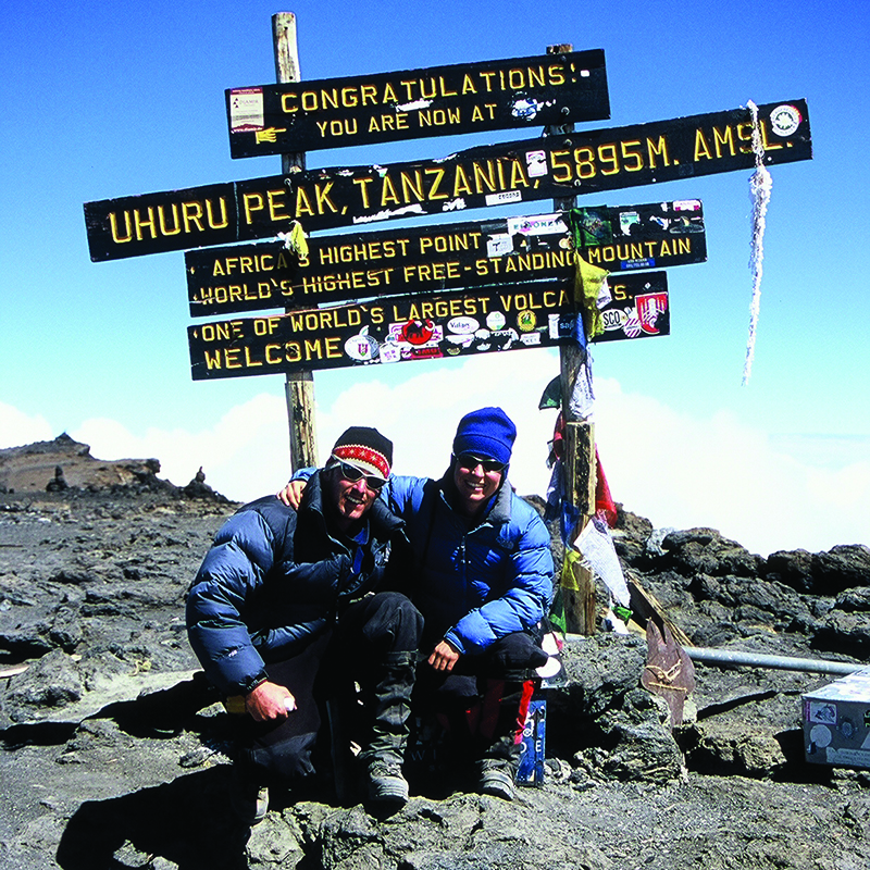 two people at the top of Kilimanjaro