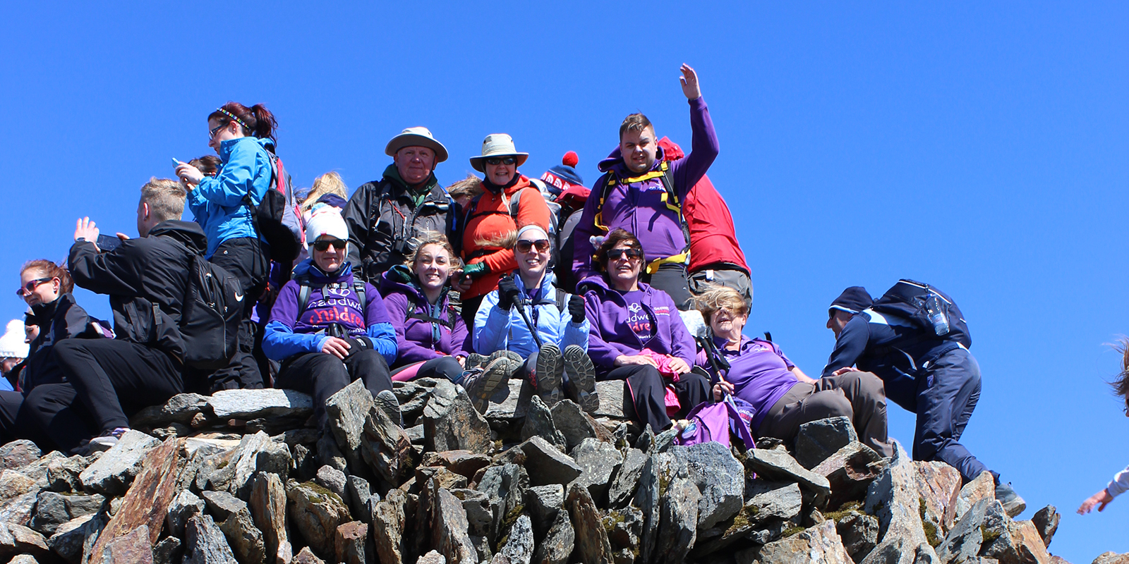 Walkers at the top of Scafell Pike
