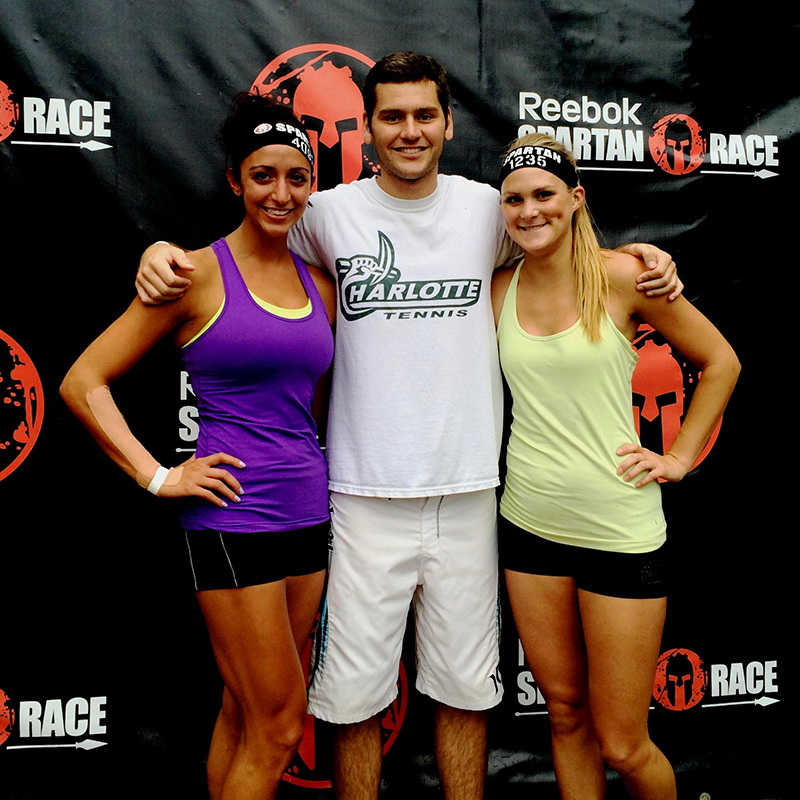 three people having completed the spartan race
