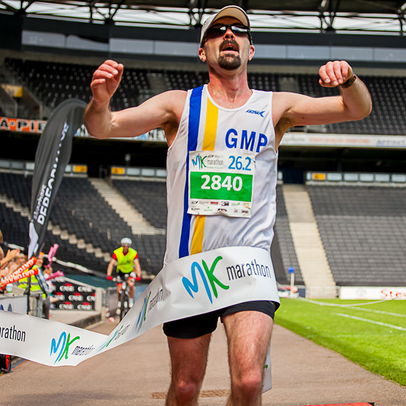 a man finishing the Milton Keynes Marathon